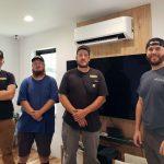 4 men in t-shirts standing in front of mini-split head