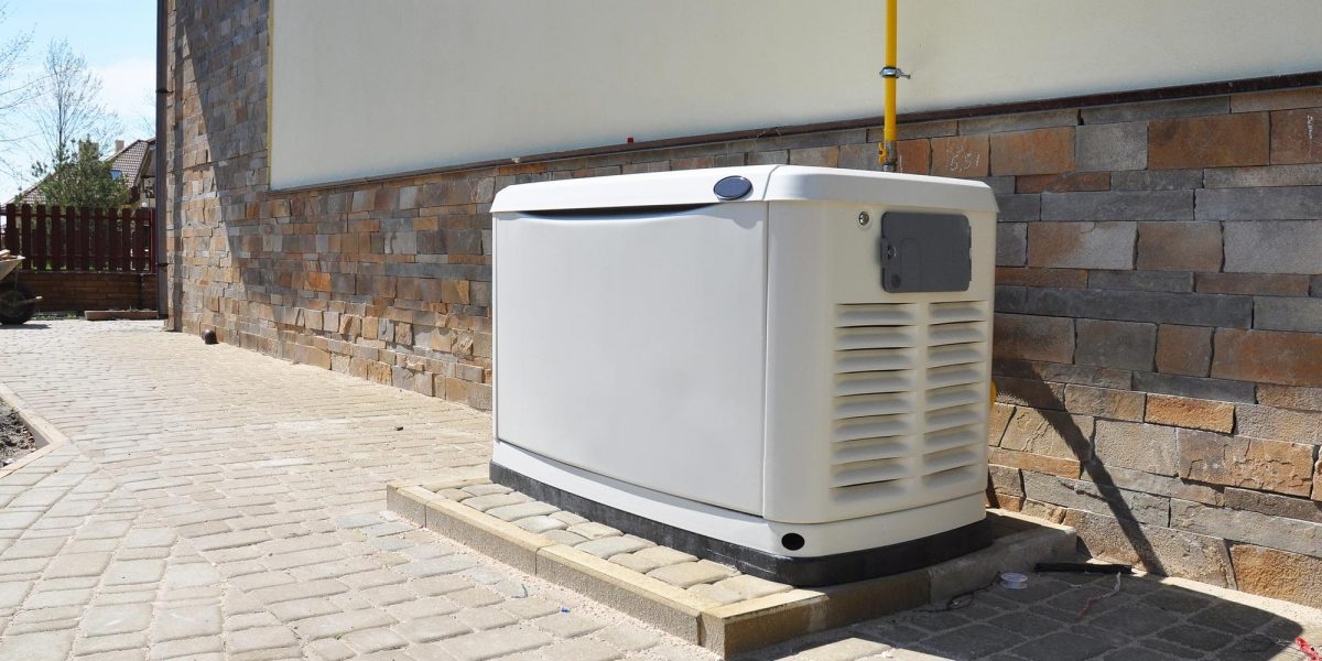generator in front of brick wall