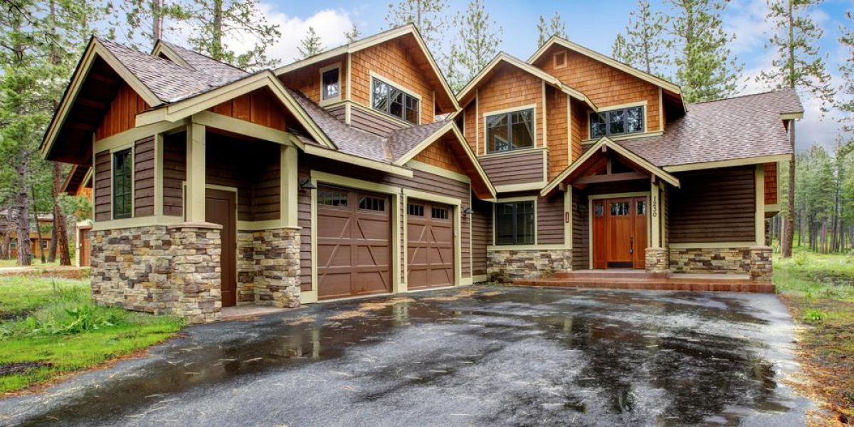 View of 2 story house with 2 car garage