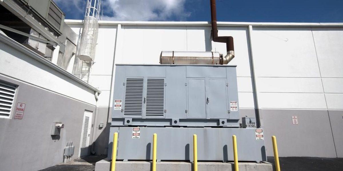 industrial generator behind a building